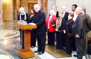Rev Nelson presenting 175 clergy names at Unicameral